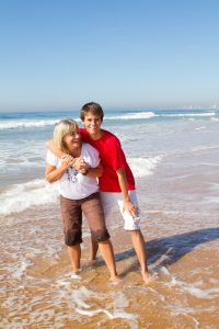 Mother and teenage son at the beach