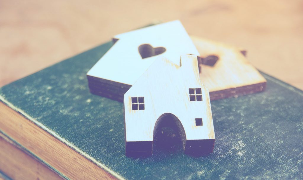 Small wooden houses on a book