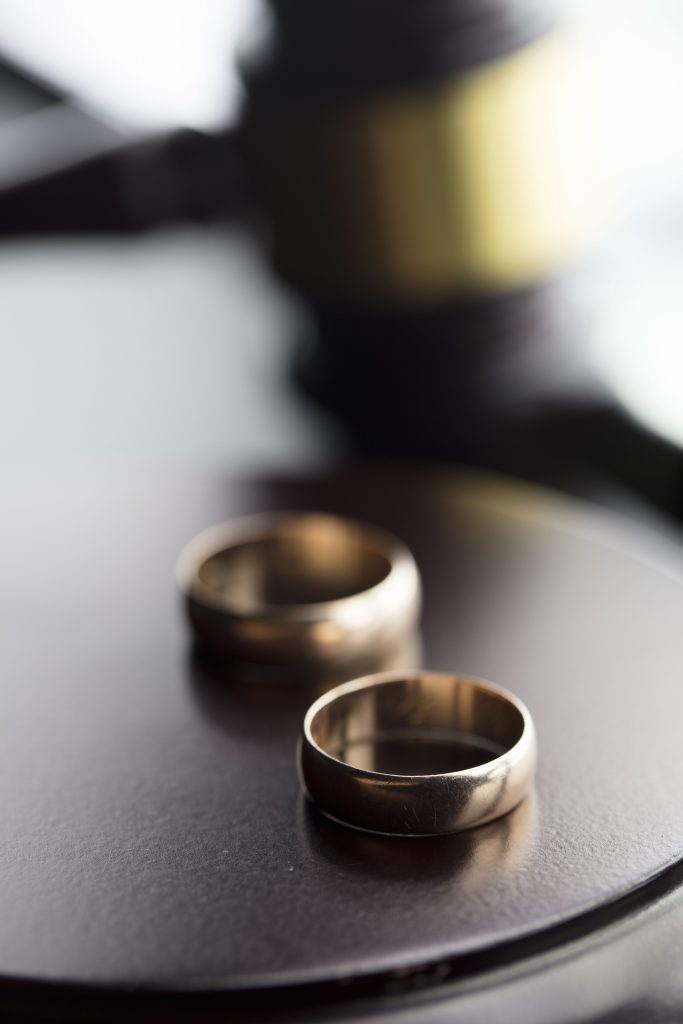 Judge's gavel and two wedding bands